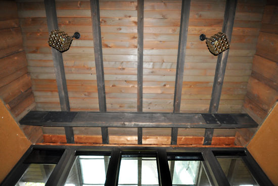 Playroom Ceiling with tongue and groove wood ceiling and heavy cedar beams