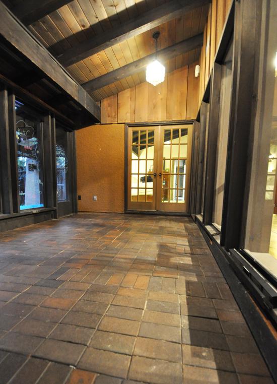 playroom interior with brick paver floor