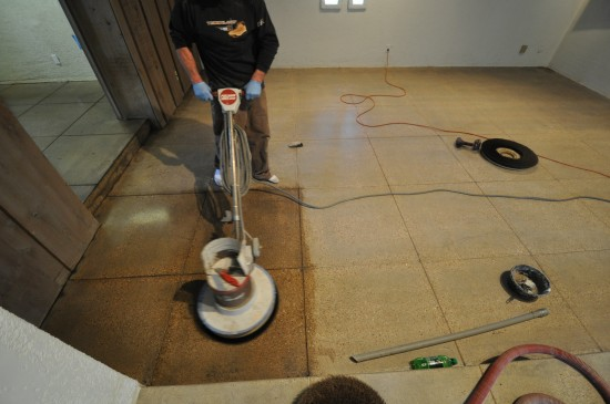 Concrete Polishing - working the wax in