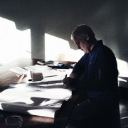 Architect Bob Borson sketching at home