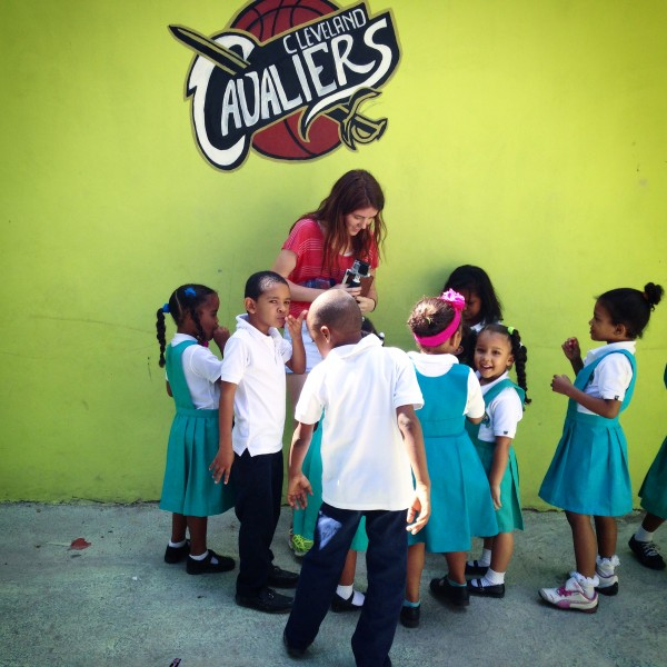 Anna Buford surround by curious children