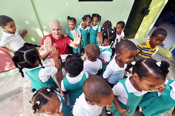 Bob Borson surrounded by children