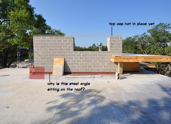 masonry wall above roof