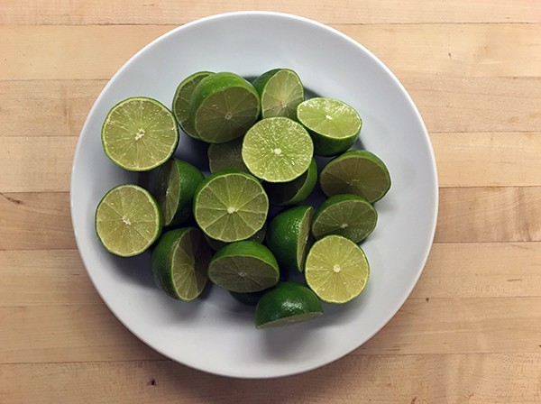 plate of sliced limes