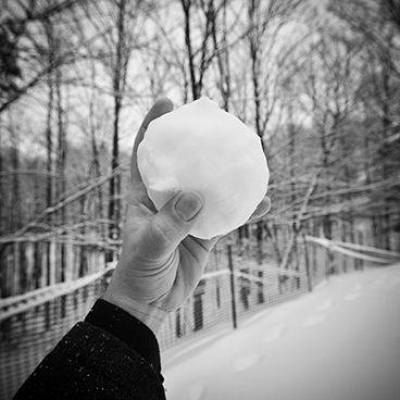 Architect throwing a snowball
