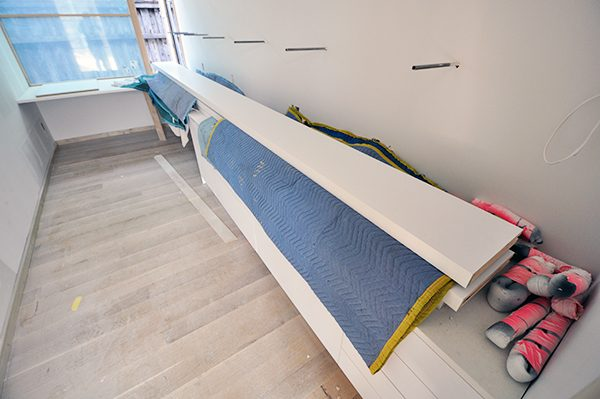 16 foot long floating shelves in the room