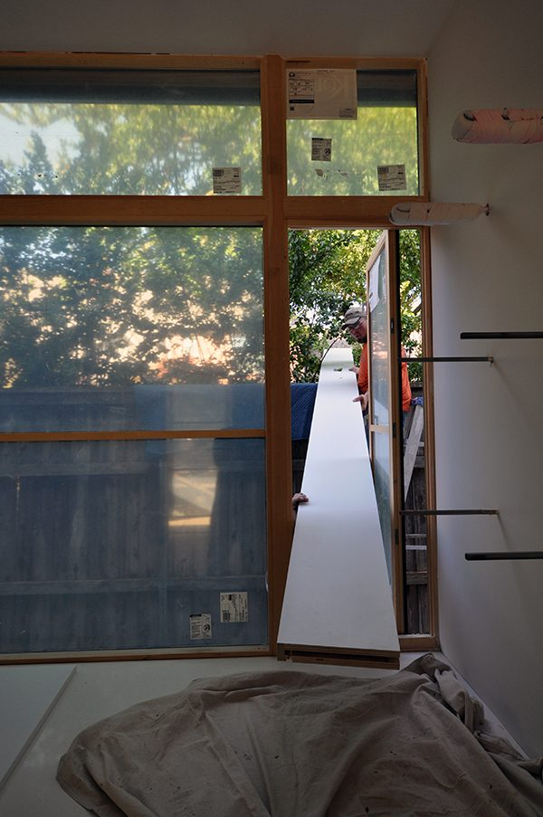 sliding the shelves in through a window