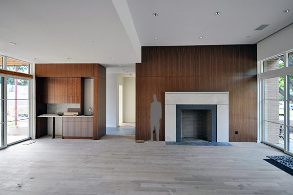 main living room fireplace surround with scale figure