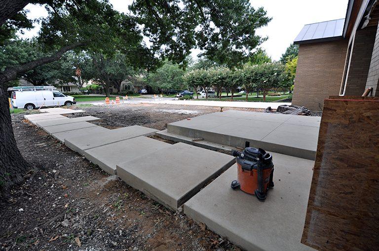 concrete sidewalk - floating pads