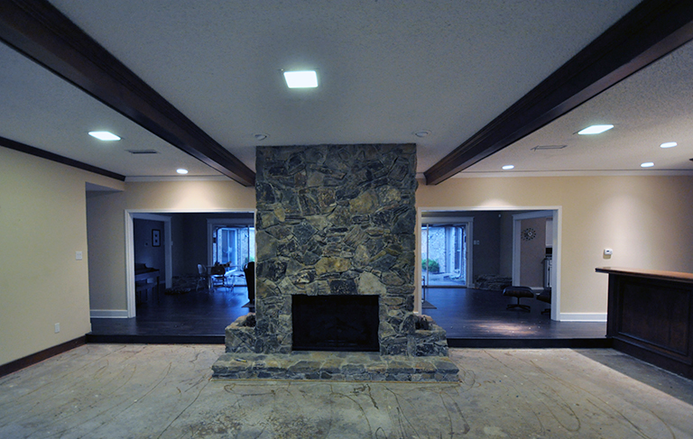 living room fireplace with concrete floor